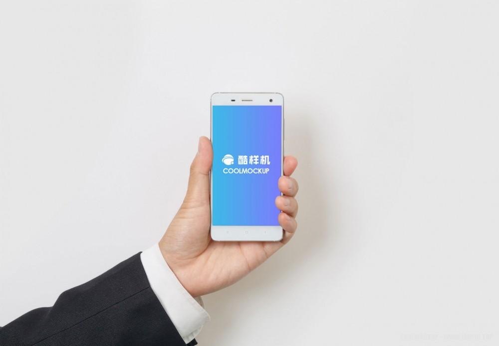 白色简约iPhone正面手持手机